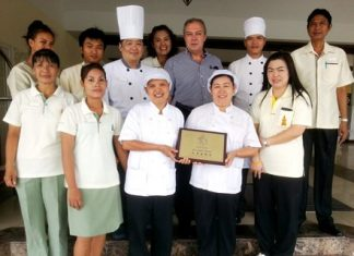 Rene Pisters (3rd right rear), GM of the Thai Garden Resort stands proudly with his team after having received the prestigious award from the Department of Tourism, Ministry of Tourism and Sports.