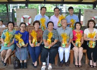 Mitr and Wattana Rattanaopat (seated, center) and family members held the ceremony to mark the 26th anniversary of the A-One Royal Cruise Hotel.
