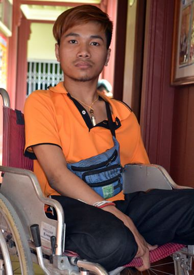 Eighteen year old Man, with his new wheelchair.