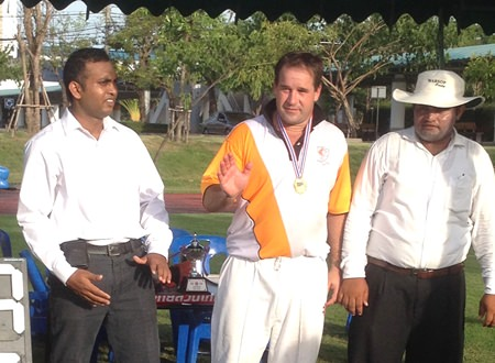 Dave Callick (center) won the man of the match award following his fine performance with both bat and ball.