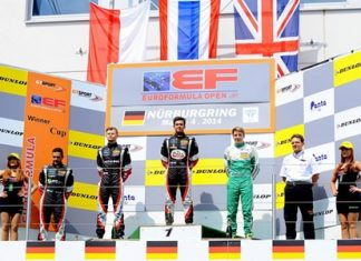 Sandy Stuvik (center) stands on the podium as the Thai national anthem is played at the end of race 2 of the opening weekend of the EuroFormula Open at the Nurbürgring in Germany, Sunday, May 4.