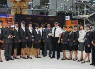 Co-pilot and crew of the Etihad Airways flight departing Bangkok on the day of the Airline's 10th anniversary, welcome guests at Bangkok's Suvarnabhumi Airport.