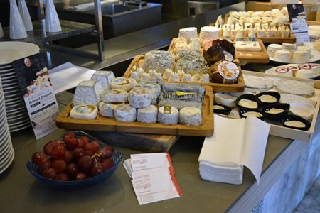The vast selection of cheese available at the cheese dinner.