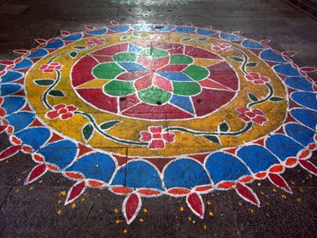 Kolam, a form of painting that is drawn by using rice powder chalk, chalk powder, white rock powder and often using naturally synthetically colored powders.