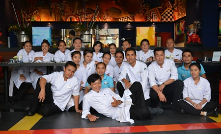 The hard working chef & kitchen team pose for a photo after finishing the preparations.