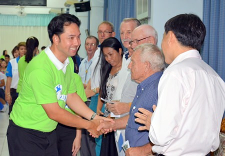 Mayor Itthiphol Kunplome shakes Bernie Tuppin's hand, thanking him and other PSC Charity members for their support.