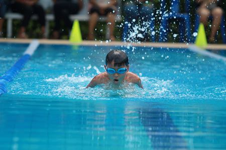 A GIS student demonstrates the butterfly stroke.