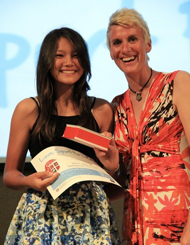 PE Teacher Roslyn McConnell hands a trophy to another deserving student.