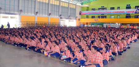 Students from Pattaya School No. 8 listen to speakers teaching the dangers of smoking.
