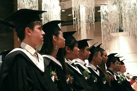 The class of 2014 listen attentively to the speeches in the Hilton Ballroom.