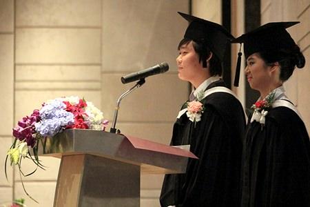 Head Boy and Head Girl for 2013-2014, Kun Woo and Joyce, address their fellow graduates.