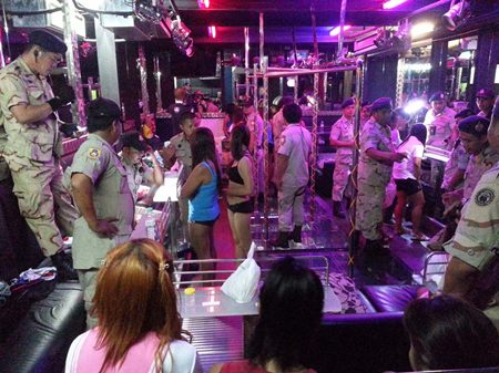 Police found 4 underage girls during a raid of Walking Street's Ginza go-go bars.