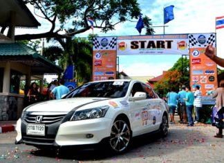 Cars head out from the Diana Garden Resort in North Pattaya at the beginning of the rally.