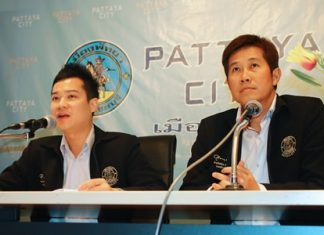 Pattaya spokespeople Damrongkiat Phinitkan (left) and Banjong Banthoonprayuk (right) say that city hall can put up traffic signs and lights, but it's up to the police to actually enforce them.