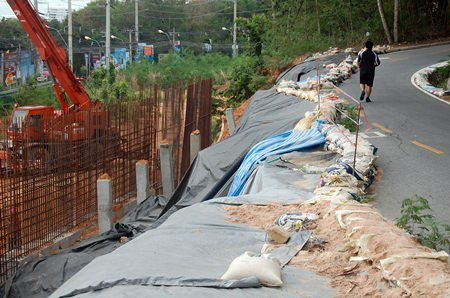 An earthen wall under construction at a View Talay Condo building site on Big Buddha Hill collapsed on June 5, but no one was injured.