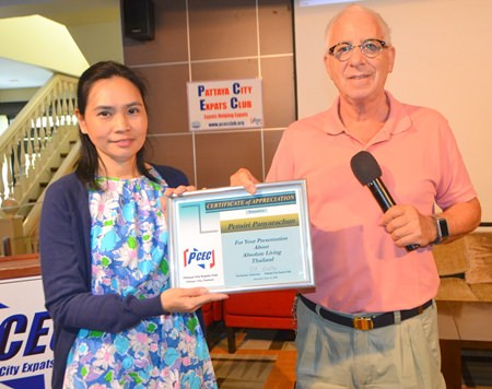 PCEC's MC Richard Silverberg presents Pensiri with a Certificate of Appreciation for her presentation.