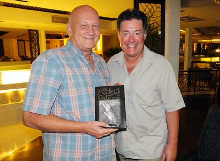 "Past President Jan Abbink (left) receives a signed copy of ""The Perfect Pair"" from author David C Holroyd (right)."