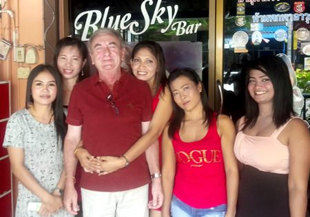 The Bliss (3rd left) celebrates his golfing victory with the staff at Blue Sky Bar.