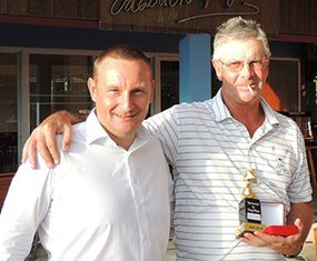 Bob St. Aubin (right) accepts his DeVere trophy and medal from the day's sponsor, Greg Hirst.