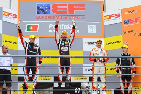 Thailand's Sandy Stuvik (centre) celebrates on the podium after winning Race 2 of the Euro Formula Open round at the Portimao Circuit in Portugal, Sunday, June 8.
