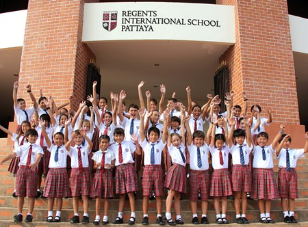 Regents Primary students cheer for a team photo during the FOBISIA in Malaysia.
