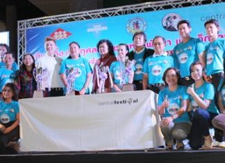 Officials from the YWCA Association, Pattaya City Hall, Central Pattaya Beach and the Pattaya Walk-Run Club pose at the June 12 press conference to announce the walk-run event.