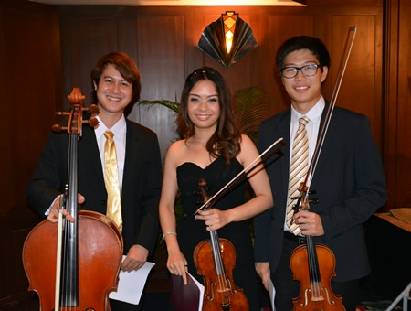 String players from the Pro Musica Orchestra smile after giving a stirring performance of work by Wolfgang Amadeus Mozart at the Siam Bayshore Hotel in Pattaya on Saturday, July 12.