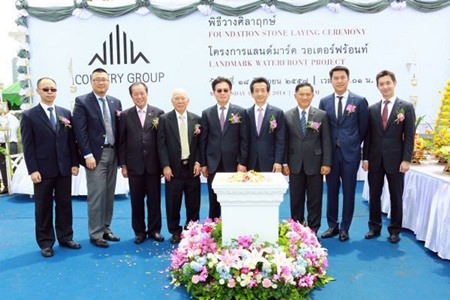 Country Group Development directors and executives pose for a photo during the merit making and stone laying ceremony for the Landmark Waterfront project in Bangkok, June 23.