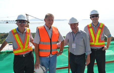 From left: Nigel Cornick, CEO of Kingdom Property; Trever Antony, Development Director, Kingdom Property; Paul Strachan of Pattaya Mail Media Group; and David Johnson, Managing Director of Delivering Asia Communications, pose at the Southpoint construction site.