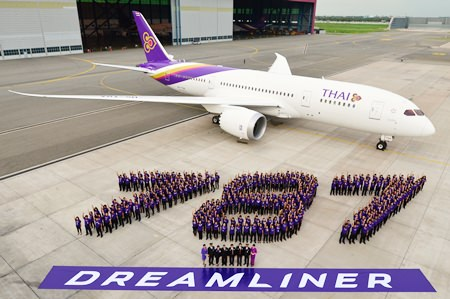 """A highlight of the day was the 30-metre long by 8-metre wide formation of the """"787"""" identity by over 300 people from THAI management, staff and guests in front of the parked Dreamliner aircraft."""