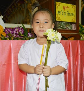 Little Wha-Wha participates in the wien thien ceremony.