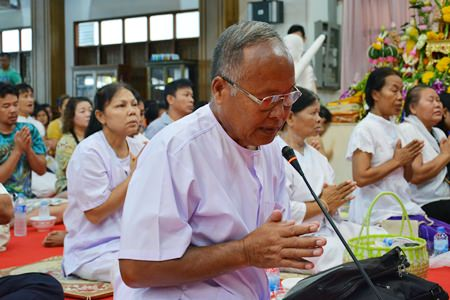 Makthayok (prayer leader) leads Asalaha Bucha Day prayers.
