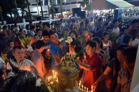Citizens present candles and flowers in hopes they and their families will prosper.