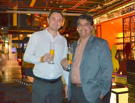 Dmitry Chernyshev and Tony Malhotra chat over a glass of beer at the end of the evening.