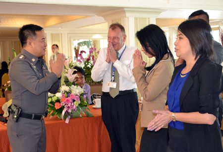 Pol. Col. Suppatee Boonkrong, Deputy Commander of the Chonburi Provincial Police brings hearty good wishes as he is greeted by Pär Kågeby, Senior Consular Officer, Embassy of Sweden, Bangkok and hotel staff.