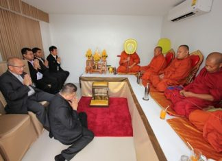 Buddhist monks perform religious ceremonies to sanctify the new Swedish Consulate.