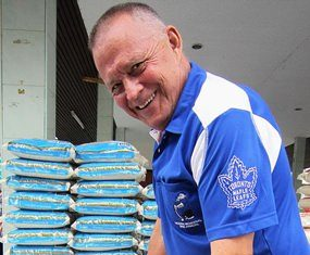 Bill hands out rice to families with disabled children in Nongprue.