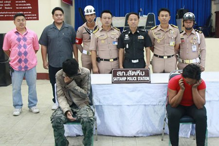 Sattahip military and police officials arrested suspected human-trafficker Nong Pimpmanee (right) and accused loan shark Thanasak Senna (left).