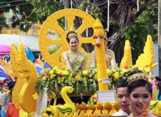 Buddhists across the Eastern Seaboard lit the way for monks heading into seclusion with candle parades to mark the start of Buddhist Lent. Shown here is the beautiful effort from Lerdpanya School in Sattahip, which won the candle-carving competition there for the fourth consecutive year.