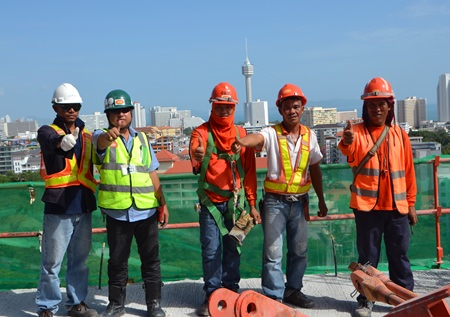 Foreign laborers who have obtained temporary work visas are back to work at construction sites around Pattaya.