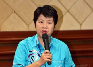 Pattaya Women's Development Group President Naowarat Khakhay presides over the meeting.