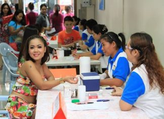 """A Soi 6 employee receives a free blood and health check during this year's """"voluntary counseling and testing day""""."""