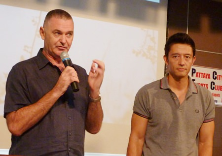 """Peter Lloyd explains how he wrote the screenplay, acted in, and co-produced the short film """"Clueless?"""" for the Bangkok 9Filmfest while Byron Bishop looks on."""