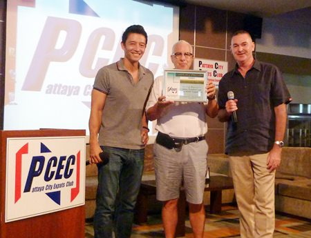 """PCEC MC Richard Silverberg presents a certificate of appreciation to Peter and Byron for their special screening of """"Clueless?"""" for the enjoyment of PCEC members and guests."""