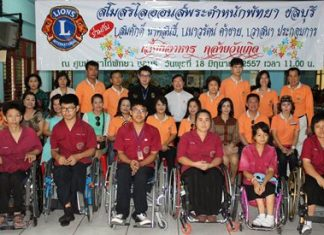 Lions Club Pratamnak Pattaya-Chonburi club secretary Somsak Naksonthi, along with Naowarath Khakhai and Wasana Prakobkarn pose for a commemorative photo after serving lunch to 300 students at the Redemptorist Vocational School for People with Disabilities.