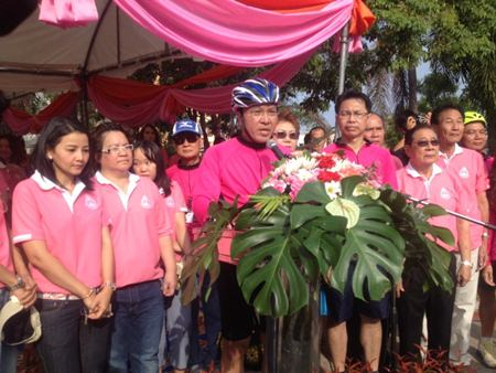 Wattana Withayakul from Region 3's Office of the Chief Justice announces the start of the 'Bicycle for Fun with Pattaya Courthouse' event.