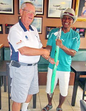 Dick Warberg (left) presents the MBMG Group Golfer of the Month award to Landis Brooks.