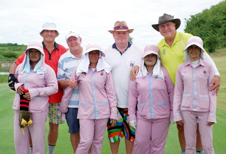 Bill, Joe, Woolly and Rosco pose with their caddies at Silky Oak.