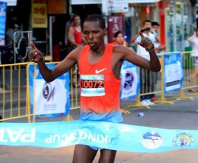Kenya's Alex Melly crosses the finish line in a time of 2.25:32 hours to win the 2014 King's Cup Pattaya Marathon, Sunday, July 27.