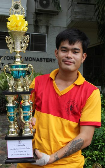 A proud athlete holds the winning trophy.